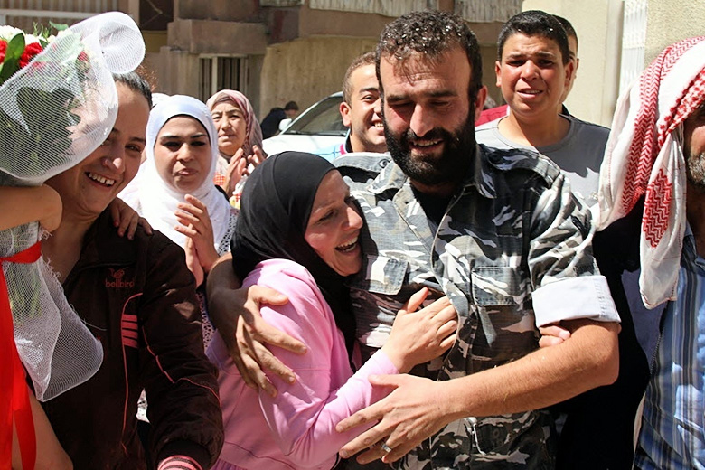 /AFP/Getty Images // Saleh al-Baradei, a Lebanese police officer kidnapped along with four soldiers by the Al-Nusra Front, the Syrian branch of Al-Qaeda, celebrates with relatives after his release on Aug. 31, 2014.