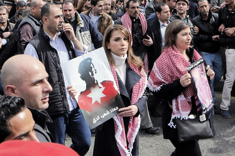 CNN // Jordanian Queen Rania, center, holds a placard during a demonstration in Amman, Jordan, on Friday, February 6, after the death of pilot Moath al-Kasasbeh by ISIS.
